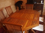 Teak extending dining table and chairs